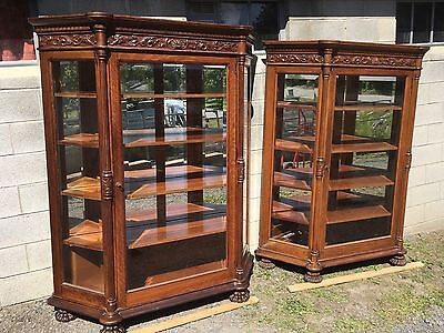 Pair Of Carved Oak Beveled Glass Collector Cabinets