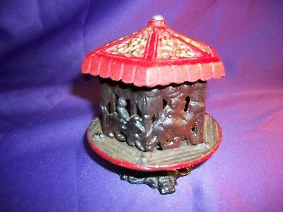CAST IRON CAROUSEL BANK  RED & BLACK Merry Go Round VINTAGE Horse Camel Lion