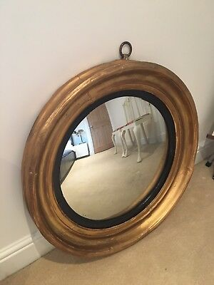 Antique Georgian round gold Mirror. Plaster, foxed, gilded.