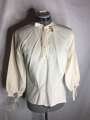 The pilot Blouse Vintage 1960s 1970s Cream Bow Blouse modcloth anthropology