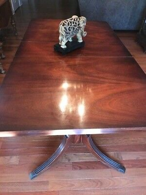 Gorgeous Flame Mahogany Double Pedestal Dining Room Table with Brass Feet.