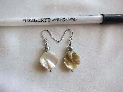 White mother of pearl type fashion earrings