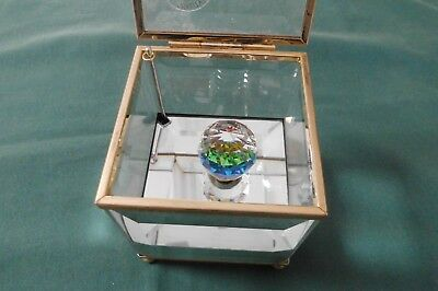 Glass music box. Square with opening lid and lovely coloured prism inside.