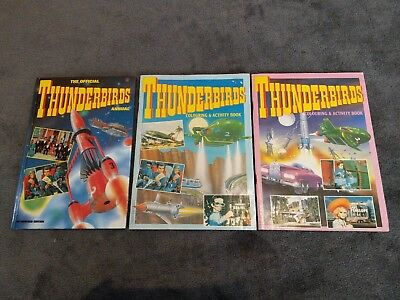 Vintage thunderbirds books. 1 official annual + 2 colouring activity books. LOOK