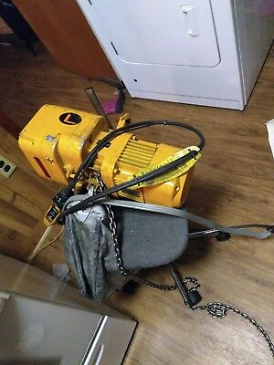 its a harrington 1/2 ton electric chain hoist w/ remote, extended 15' chain, and