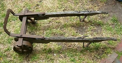 All the wrought iron bits for an antique railway trolley - restore or as is?
