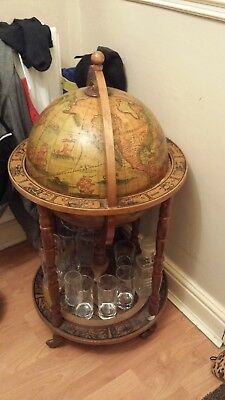 50 year old wooden globe with all zodiac signs. latin descriptions