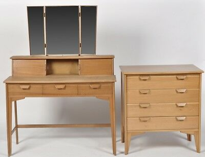 A Mid 20 Century Chest Of Drawers And Dressing Table