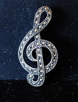 Solid silver and marcasite musical clef brooch