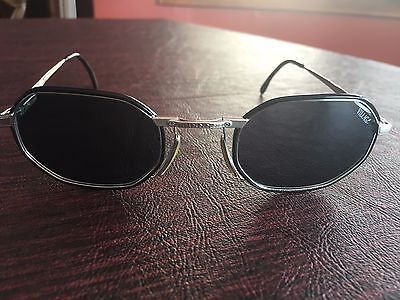 Village by Marcolin Sunglasses Octagonal Black and Silver