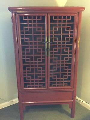 Red lacquered Chinese cabinet 20th century.