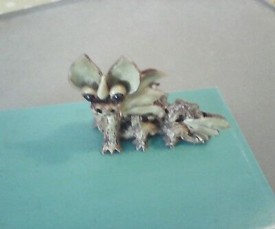 Yare pottery dragon one ear has been repaired.