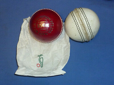 New Kookaburra 2 Piece 156 gram Red Cricket Ball Match Leather + 1 x White Used