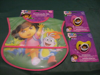 Nickelodeons Dora the Explorer 2-Pacifiers and Crumb Catcher Bib Lot of 3 NEW!