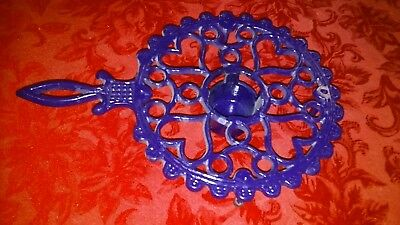 Round cast iron trivet with handle. large one