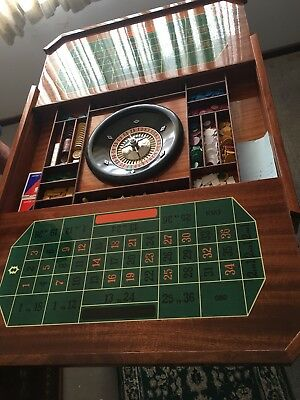 Casino Style Games Table With Roulette Wheel