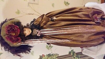 Victorian doll with stand.