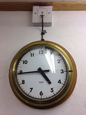 GENT Solid Brass Electric Wall Clock on a Solid Oak Surround