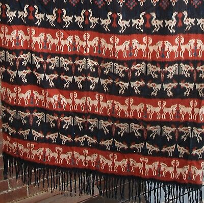 Ikat: large bright hand dyed and woven fabric wall hanging from Sumba Indonesia