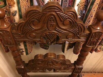 antique solid oak deeply carved pair of chairs