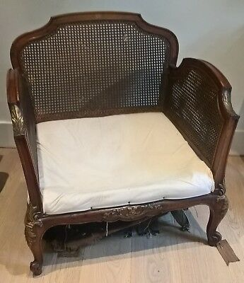 Original Antique Bergere style gilded armchair.