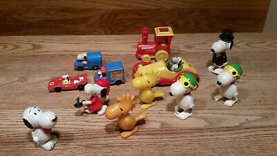 Snoopy Lot of 12  Pieces,  Peanuts Vintage Die Cast Cars 5 wind up toys