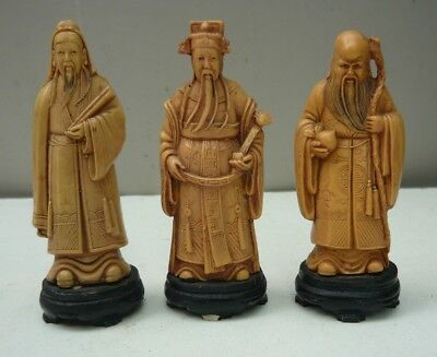 Three old hand carved Chinese men on signed black plinths - 1 has minor damage