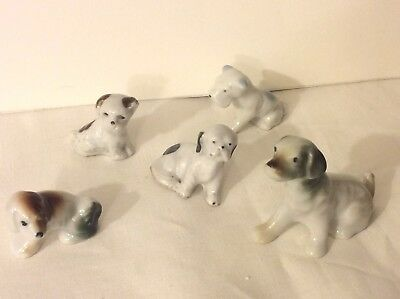 Lot of 5 vintage dog figurines  Likely made in japan