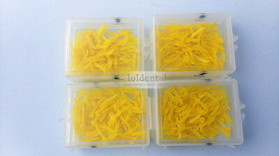 400pcs dental poly wedge disposable plastic round stern with holes middle size