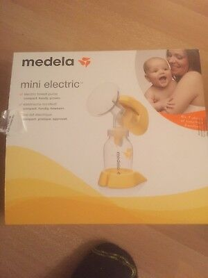 Medela Single Mini Electric Breastpump + extra bottle