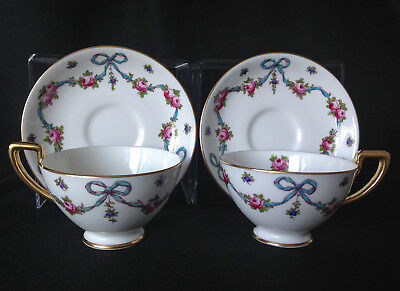 Pair of Crown Staffordshire blue bows & roses gold-handled cups & saucers