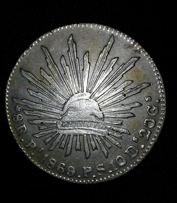 1869 Pi P.S. Republic of Mexico Silver 8 reales coin. Light chop marks