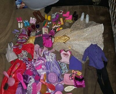 Large Lot Of Barbie/Fashion Doll Clothes and accessories