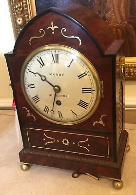 Regency bracket timepeice clock, figured mahogany, brass inlay