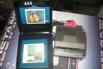 polaroid,spectra system,and polaroid casing ,cord,with manuals chaiman,president