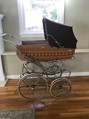 Vintage Peg Perego Pram 1970's in very good condition.  Brown w wicker base.