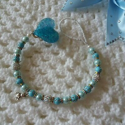 Dummy clip for baby shamballa and baby blue beads.