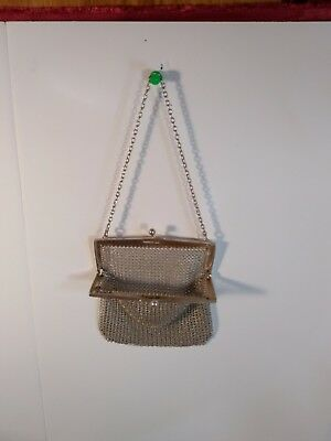 Sterling silver mesh bag that is chased, marked Sterling and dated 1913.