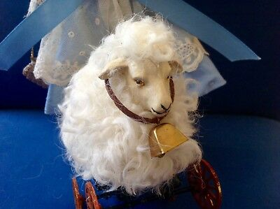 Antique style real wool primitive Easter sheep on wheels