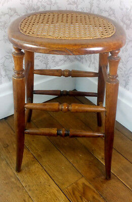 Antique 4 Legged Wooden Stool with Open Cane Seat
