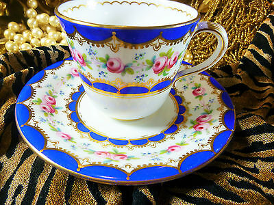 (A) ANTIQUE COALPORT COFFEE CUP AND SAUCER  HP PINK ROSES BLUE TRIM GOLD c1815