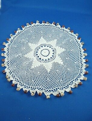 VINTAGE GLASS BEADED JUG COVER WITH FINE WHITE CROCHETED BODY 26 cms
