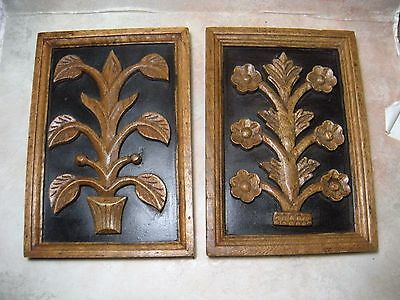 Two hand carved wood panel flowers