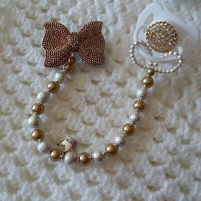 Stunning Dummy charm clip for baby. Gold and silver.