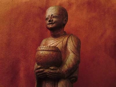 1920s Burmese carved wooden Buddhist  monk with begging bowl figure