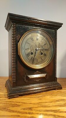 ATTRACTIVE VICTORIAN BRASS FACED MANTEL CLOCK IN OAK CASE c1895