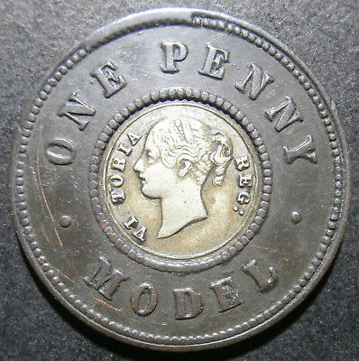 Toy money - Model penny by Moore - nose to R / m. rotation / nickel-zinc centre