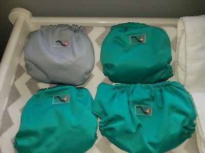 4 Rumparooz diapers w/ 4 6r soakers