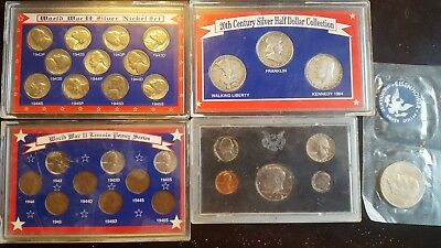 Lot of 5 coin sets sealed in plastic.