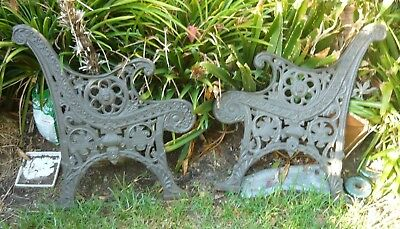 Very heavy cast iron bench ends. Lion's head decoration. Needs timber and bolts